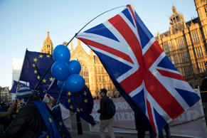 Anti Brexit pro remain demonstrators protest waving European Union and Union Jack flags in Westminster opposite Parliament on the day that Conservative Party MPs triggered a vote of no confidence in the Prime Minister on 12th December 2018 in London, England, United Kingdom. (photo by Mike Kemp/In Pictures via Getty Images)