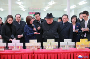 "In this Jan. 9, 2019, photo provided on Jan. 10, 2019, by the North Korean government, North Korean leader Kim Jong Un, center, visits a pharmaceutical factory in Beijing. The content of this image is as provided and cannot be independently verified. Korean language watermark on image as provided by source reads: ""KCNA"" which is the abbreviation for Korean Central News Agency. (Korean Central News Agency/Korea News Service via AP)"