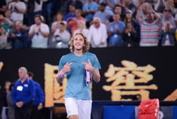 MELBOURNE, AUSTRALIA - JANUARY 20: Stefanos Tsitsipas of Greece celebrates after Australian Open 2019 Men's Singles match against Roger Federer (not seen) of Switzerland in Melbourne, Australia on January 20, 2019. Stefanos Tsitsipas won the match with 3-2.  (Photo by Recep Sakar/Anadolu Agency/Getty Images)