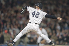 NEW YORK - CIRCA 2001 : Mariano Rivera #42 of the New York Yankees pitches against the Arizona Diamondbacks in the 2001 World Series at Yankee Stadium in the Bronx borough of New York City. The Diamondbacks won the series 4 games to 3. (Photo by Focus on Sport/Getty Images)