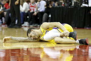 HOUSTON, TX - JANUARY 19:  Lonzo Ball #2 of the Los Angeles Lakers lays on the court after an injury in the second half against the Houston Rockets at Toyota Center on January 19, 2019 in Houston, Texas.  NOTE TO USER: User expressly acknowledges and agrees that, by downloading and or using this Photograph, user is consenting to the terms and conditions of the Getty Images License Agreement.  (Photo by Tim Warner/Getty Images)