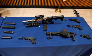 Confiscated guns are seen during a news conference about a gun bust at New York City Police (NYPD) Headquarters in New York, U.S., May 24, 2018.  REUTERS/Brendan McDermid