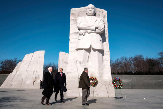 Slide 1 of 25: President Donald J. Trump and US Vice President Mike Pence visit the Martin Luther King Jr. Memorial in Washington, DC. They placed a wreath to commemorate the slain civil rights leader.