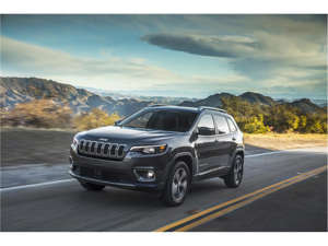 a car parked on the side of a road: 2019 Jeep Cherokee