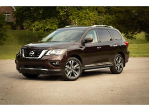 a car parked on the side of a road: 2019 Nissan Pathfinder