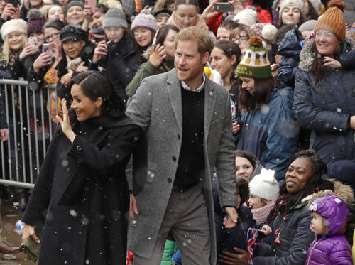Slide 1 of 91: Britain's Prince Harry and Meghan, Duchess of Sussex waves to well-wishers as they arrive for a visit outside the Old Vic Theatre in Bristol, England, Friday, Feb. 1, 2019. (AP Photo/Matt Dunham)