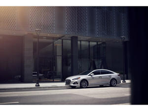 a car parked on the side of a building: 2019 Hyundai Sonata