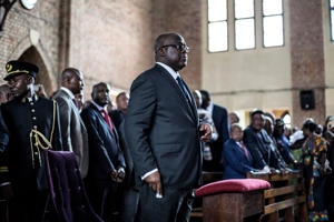Current President of the Democratic Republic of the Congo, Felix Tshisekedi, attends a mass at the Notre dame de Kinshasa to commemorate the death of his father, Etienne Tshisekedi on February 1, 2019 in Kinshasa. (Photo by JOHN WESSELS / AFP)        (Photo credit should read JOHN WESSELS/AFP/Getty Images)
