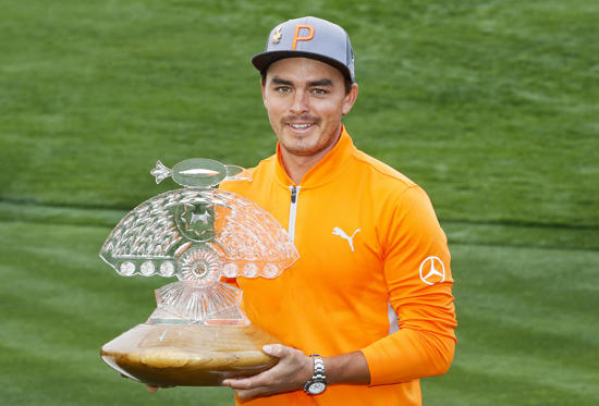 Slide 2 of 105: Rickie Fowler holds the champion's trophy after the final round of the Phoenix Open PGA golf tournament, Sunday, Feb. 3, 2019, in Scottsdale, Ariz. (AP Photo/Matt York)