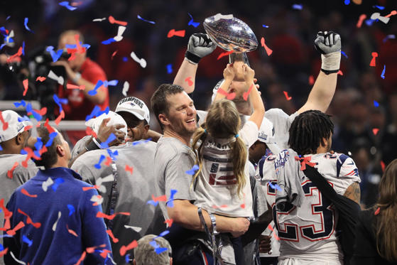 Slide 1 of 19: ATLANTA, GA - FEBRUARY 03: Tom Brady #12 of the New England Patriots celebrates with daughter Vivian who raises the Vince Lombardi Trophy after Super Bowl LIII at Mercedes-Benz Stadium on February 3, 2019 in Atlanta, Georgia. The New England Patriots defeat the Los Angeles Rams 13-3. (Photo by Mike Ehrmann/Getty Images)