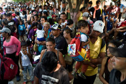 Venezuelan migrants gather outside La Divina Pastora shelter in Villa del Rosario, Colombia, in the border with Venezuela, on February 13, 2019. - La Divina Pastora, in coordination with the Catholic Church, and with the support of the United Nations World Food Programme, feeds daily more than 4000 Venezuelan migrants, who agglomerate outside its facilities since early morning. (Photo by Luis ROBAYO / AFP)        (Photo credit should read LUIS ROBAYO/AFP/Getty Images)