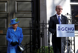 Britain's Queen Elizabeth listens to GCHQ Director Jeremy Fleming as she visits Watergate House to mark the centenary of the GCHQ (Government Communications Head Quarters) in London, Britain, February 14, 2019. REUTERS/Hannah McKay/Pool