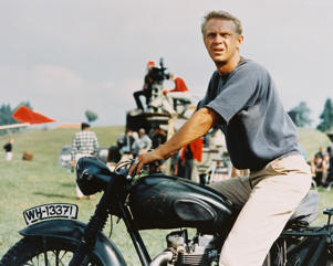 Steve McQueen sitting astride a motorcycle in the famous film of 'The Great Escape'
