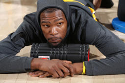 PORTLAND, OR - FEBRUARY 13: Kevin Durant #35 of the Golden State Warriors stretches before the game against the Portland Trail Blazers on February 13, 2019 at the Moda Center in Portland, Oregon. NOTE TO USER: User expressly acknowledges and agrees that, by downloading and/or using this photograph, user is consenting to the terms and conditions of the Getty Images License Agreement. Mandatory Copyright Notice: Copyright 2019 NBAE (Photo by Sam Forencich/NBAE via Getty Images)