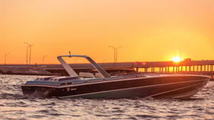 a small boat in a body of water: Miami Vice Wellcraft Boat For Sale