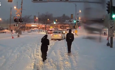 Bus driver and passengers rescue car stuck on snow-covered train tracks