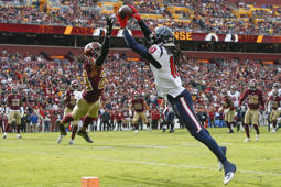 CAPTION: Houston Texans wide receiver DeAndre Hopkins (10) pulls in a touchdown pass under pressure from Washington Redskins cornerback Josh Norman (24) during the first half of an NFL football game, Sunday, Nov. 18, 2018 in Landover, Md.