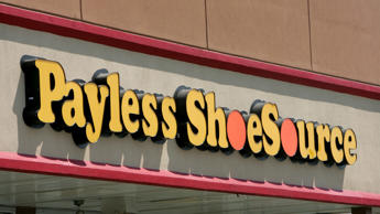 FILE- This Aug. 23, 2006, file photo shows a Payless store front is seen in Philadelphia. Paylesss ShoeSource is shuttering all of its 2,100 remaining stores in the U.S. and Puerto Rico, joining a list of iconic names like Toys R Us and Bon-Ton that have been shuttered in the last year. The Topeka, Kansas-based chain said Friday, Feb. 15, 2019 it will hold liquidation sales starting Sunday and wind down its e-commerce operations. (AP Photo/Matt Rourke, File)