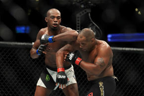 CAPTION: ANAHEIM, CA - JULY 29: (L-R) Jon Jones elbows Daniel Cormier during the UFC 214 event at Honda Center on July 29, 2017 in Anaheim, California.