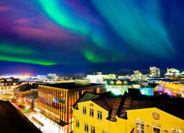 View of the northern light from the city center in Reykjavik, Iceland.