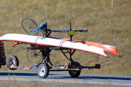 Two kayaks and a bicycle on a trailer
