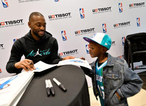 CAPTION: CHARLOTTE, NORTH CAROLINA - FEBRUARY 15: Kemba Walker #15 of the Charlotte Hornets at he Tissot Style Lounge during NBA All-Star Weekend 2019 at the EPICENTRE on February 15, 2019 in Charlotte, North Carolina.