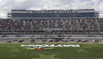 William Byron (24) and Alex Bowman (88) lead the field at the start of a NASCAR Daytona 500 auto race Sunday, Feb. 17, 2019, at Daytona International Speedway in Daytona Beach, Fla. (AP Photo/Chris O'Meara)