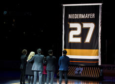 ANAHEIM, CA - FEBRUARY 17:  Former Anaheim Duck, Scott Niedermayer watches his jersey rise to the rafters with his family during the jersey retirement ceremony prior to the game between the Anaheim Ducks and the Boston Bruins on February 17, 2019 at Honda Center in Anaheim, California. (Photo by Debora Robinson/NHLI via Getty Images)