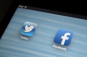 General view of the Twitter app icon next to the Facebook app icon being viewed on an iPad.   (Photo by Andrew Matthews/PA Images via Getty Images)