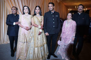 Reliance Industries Chairman Mukesh Ambani, his wife Nita Ambani, his daughter Isha, groom Anand Piramal, and his mother Swati Piramal and father Ajay Piramal pose during the wedding reception of Isha Ambani and Anand Piramal at Jio Garden on December 14, 2018 in Mumbai, India.