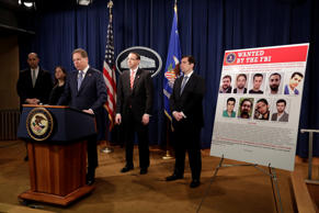 U.S. Deputy Attorney General Rod Rosenstein listens to Attorney Geoffrey Berman for the Southern District of New York speaking at a news conference with other law enforcement officials at the Justice Department to announce nine Iranians charged with conducting massive cyber theft campaign, in Washington, U.S., March 23, 2018.