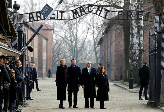 "Slide 1 of 34: U.S. Vice President Mike Pence with his wife Karen and Poland's President Andrzej Duda with first lady Agata Kornhauser-Duda stand at the ""Arbeit Macht Frei"" gate at the former Nazi German concentration and extermination camp Auschwitz in Oswiecim, Poland, February 15, 2019"