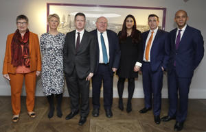 Seven MPs from left, Ann Coffey, Angela Smith, Chris Leslie, Mike Gapes, Luciana Berger, Gavin Shuker and Chuka Umunna, pose for a photograph after a press conference to announce the new political party, The Independent Group, in London, Monday, Feb. 18, 2019. Seven British Members of Parliament say they are quitting the main opposition Labour Party over its approach to issues including Brexit and anti-Semitism. Many Labour MPs are unhappy with the party's direction under leader Jeremy Corbyn, a veteran socialist who took charge in 2015 with strong grass-roots backing. (AP Photo/Kirsty Wigglesworth)