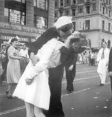 ADDS INFORMATION ABOUT PHOTOGRAPHER- FILE - In this Aug. 14, 1945 file photo provided by the U.S. Navy, a sailor and a woman kiss in New York's Times Square, as people celebrate the end of World War II. The ecstatic sailor shown kissing a woman in Times Square celebrating the end of World War II has died. George Mendonsa was 95. This image was taken by U.S. Navy photographer Victor Jorgensen. The photo is of the same moment that photographer Alfred Eisenstaedt captured and first published in Life magazine. (Victor Jorgensen/U.S. Navy, File)