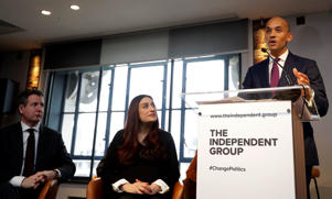 Chaka Umunna speaks alongside Luciana Berger and Chris Leslie, left, during a press conference to announce the new political party, The Independent Group, in London, Monday, Feb. 18, 2019. Seven British Members of Parliament say they are quitting the main opposition Labour Party over its approach to issues including Brexit and anti-Semitism. Many Labour MPs are unhappy with the party's direction under leader Jeremy Corbyn, a veteran socialist who took charge in 2015 with strong grass-roots backing. (AP Photo/Kirsty Wigglesworth)