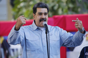 Venezuela's President Nicolas Maduro speaks during an event at Bolivar Square in Caracas, Venezuela, Thursday, Feb. 7, 2019. Maduro said that he hopes to collect 10 million signatures demanding that Washington withdraw threats of war against the people of Venezuela. (AP Photo/Ariana Cubillos)
