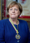 19 February 2019, Berlin: Federal Chancellor Angela Merkel (CDU) receives 'Prinzenpaare' from all federal states in the Federal Chancellery, awarded with a medal. Photo: Kay Nietfeld/dpa (Photo by Kay Nietfeld/picture alliance via Getty Images)