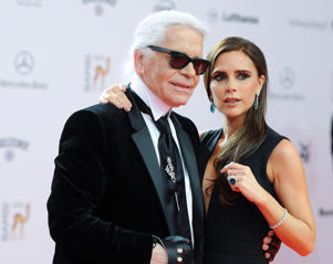 Karl Lagerfeld (L) and Victoria Beckham arrive at the 65th Bambi award ceremony at the Stage Theater in Berlin, Germany, 14 November 2013. The Burda media prize is awarded in 17 categories at the Stage Theater in Berlin on 14 November 2013. Photo: Britta Pedersen/dpa | usage worldwide   (Photo by Britta Pedersen/picture alliance via Getty Images)