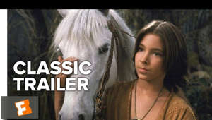 Noah Hathaway standing in front of a horse: Subscribe to CLASSIC TRAILERS: http://bit.ly/1u43jDe Subscribe to TRAILERS: http://bit.ly/sxaw6h Subscribe to COMING SOON: http://bit.ly/H2vZUn Like us on FACEBOOK: http://bit.ly/1QyRMsE Follow us on TWITTER: http://bit.ly/1ghOWmt The Never Ending Story (1984) Official Trailer - Childhood Fantasy Movie HD  A troubled boy dives into a wonderous fantasy world through the pages of a mysterious book.  Welcome to the Fandango MOVIECLIPS Trailer Vault Channel. Where trailers from the past, from recent to long ago, from a time before YouTube, can be enjoyed by all. We search near and far for original movie trailer from all decades. Feel free to send us your trailer requests and we will do our best to hunt it down.