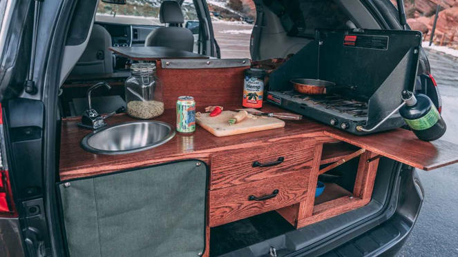 a car that is sitting on a table: Oasis Campervans conversion