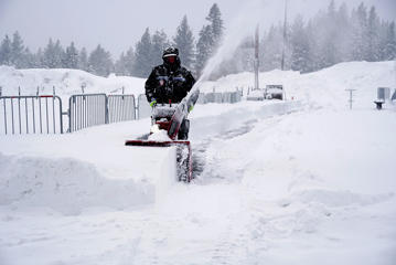A worker operates a snow blower at Heavenly Mountain Resort near South Lake Tahoe, Calif, on Friday, Feb. 15, 2019.