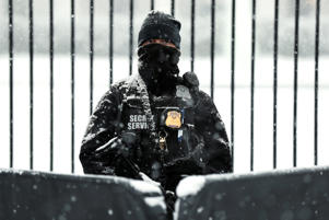 A snow covered member of the Secret Service keeps watch in front of the White House in Washington, U.S., February 20, 2019.