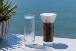 Iced coffee drink by the sea in Greece