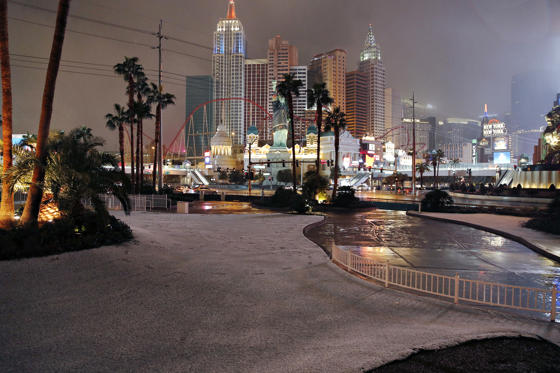 Slide 1 of 67: A dusting of snow covers an area along the Las Vegas Strip, Thursday, Feb. 21, 2019, in Las Vegas. A winter storm is expected to drop up to 3 inches (8 centimeters) of snow on Las Vegas' southern and western outskirts while other parts of the metro area will get rain mixed with snow.