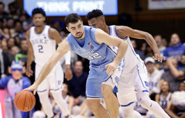 Duke's Javin DeLaurier guards North Carolina's Luke Maye (32) during the second half of an NCAA college basketball game in Durham, N.C., Wednesday, Feb. 20, 2019. North Carolina won 88-72. (AP Photo/Gerry Broome)