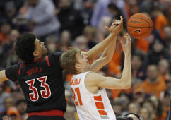 Louisville's Jordan Nwora, left, and Syracuse's Marek Dolezaj, right, battle for a rebound during the second half of an NCAA college basketball in Syracuse, N.Y., Wednesday, Feb. 20, 2019. Syracuse won 69-49. (AP Photo/Nick Lisi)
