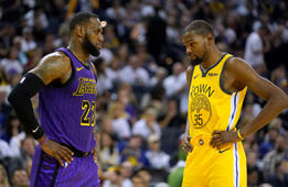 Los Angeles Lakers forward LeBron James (23) talks to Golden State Warriors forward Kevin Durant during the second half of an NBA basketball game Tuesday, Dec. 25, 2018, in Oakland, Calif. The Lakers won 127-101. (AP Photo/Tony Avelar)