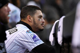 Colorado Rockies third baseman Nolan Arenado sits in the dugout in the ninth inning of Game 3 of a baseball National League Division Series against the Milwaukee Brewers Sunday, Oct. 7, 2018, in Denver. The Brewers won 6-0 to sweep the series in three games and move on to the National League Championship Series. (AP Photo/John Leyba)