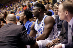 Duke's Zion Williamson (1) is attended to on the bench following an injury during the first half of an NCAA college basketball game against North Carolina in Durham, N.C., Wednesday, Feb. 20, 2019. (AP Photo/Gerry Broome)