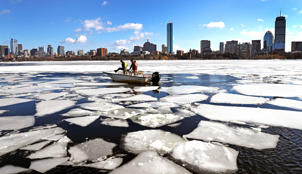 Members of the MIT sailing team use boats to break up the ice on the Charles River in Cambridge, MA in preparation for the start of the sailing season on Feb. 21, 2019. (Photo by David L. Ryan/The Boston Globe via Getty Images)